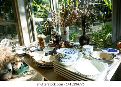 many vintage thai ceramic table ware on table