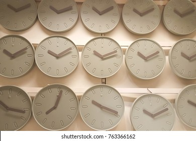 many wall clocks light green grey background