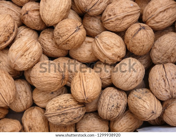 Many walnuts lying in a pile