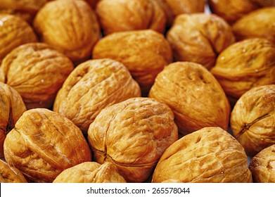 many walnuts very close up