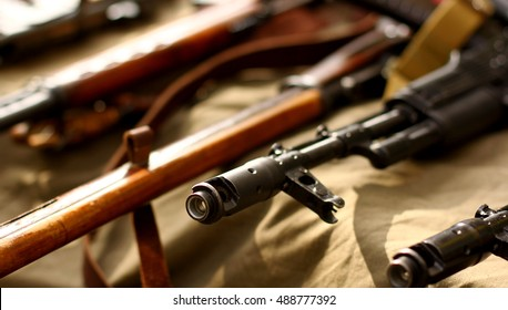 Many weapon arsenal on military background