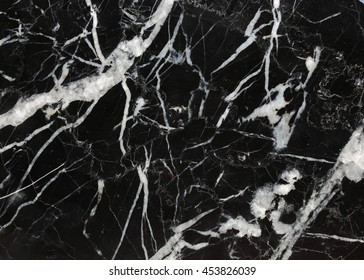 Many white patterned natural of black marble (Marquina) texture.
