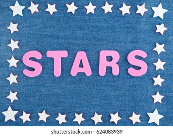 Many white stars placed in rectangle, in the middle the word Stars, background from blue jeans