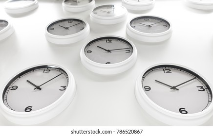 Many white wall clock isolated on white background