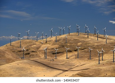 many wind power generator on grass hills