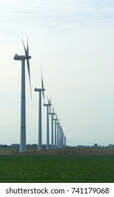many wind turbines to produce electricity with the force of wind in the plain
