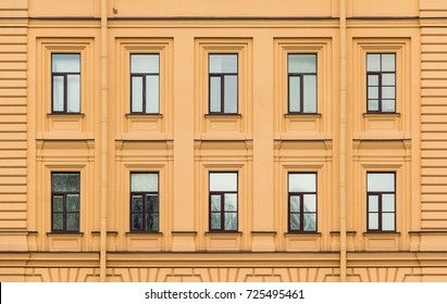 Many windows in a row on facade of urban office building front view, St. Petersburg, Russia