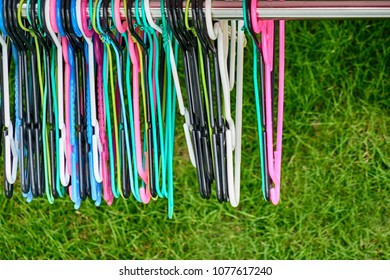 Many wire and plastic hangers
