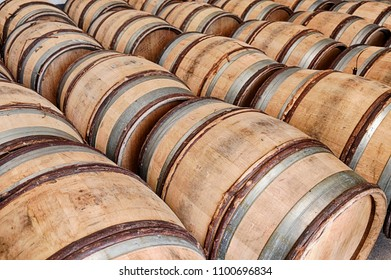 Many wooden barrels are waiting for wine in a winery near the town of Chablis in France.