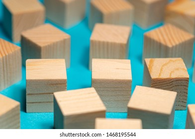 many wooden blocks are laid out haphazardly, a place for your text. Blue background selective focus