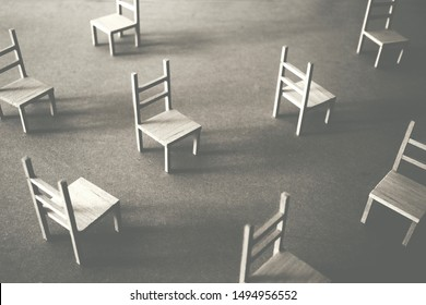 many wooden chairs in chaotic disposition