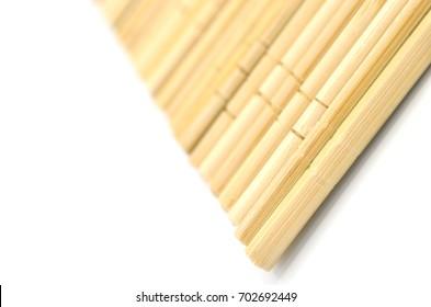 Many wooden chopsticks isolated on white background.