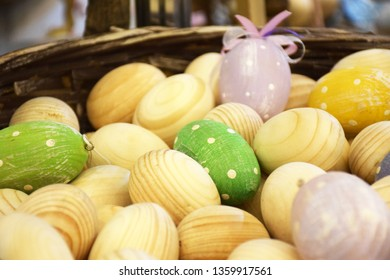 Many wooden Easter eggs in a basket. Slavic Pysanky, wooden blanks, with selective focus.
