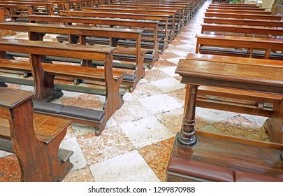 many wooden empty pews in the church without people