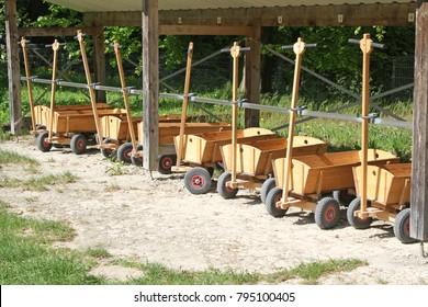 many wooden handcarts