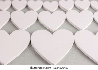 many wooden hearts on craft background