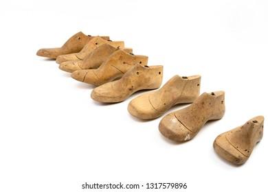 Many wooden lasts