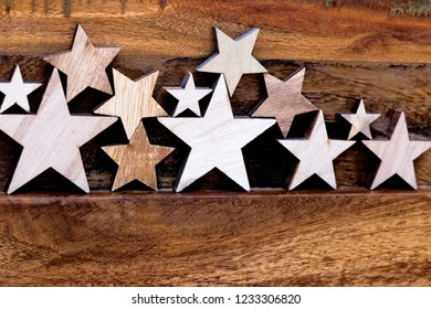Many wooden stars placed on a wooden table