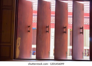 Many wooden windows are open.