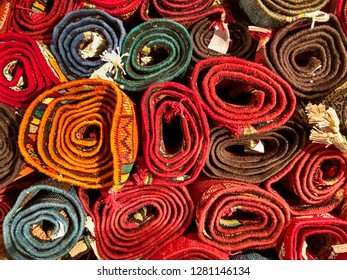 Many wool carpets are rolled up and waiting to be sold in a rug store in Fes, Morocco.