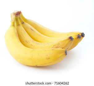 Many yellow isolated bananas over white background