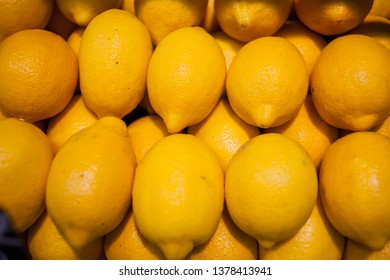 many yellow lemons. Yellow lemon background. Healthy fruits, lemon fruits background many lemon fruits in store. texture of lemon at supermarket shop