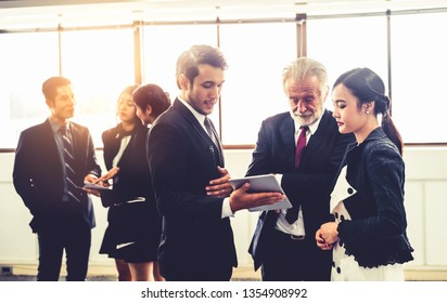 Many young businessmen and businesswomen in group meeting standing at conference hall in the office. Multicultural company organization unity and support. Concept of partnership and human resources.