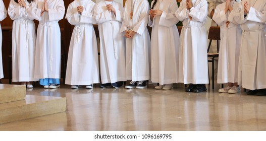 many young people at first communion in the church during the holy mass