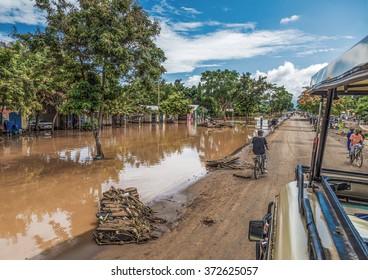 MANYARA, TANZANIA - NOVEMBER 28, 2011: The catastrophic mudflow destroyed a road between national parks Manyara and Ngorongoro. Car traffic was restored on the same day in Tanzania