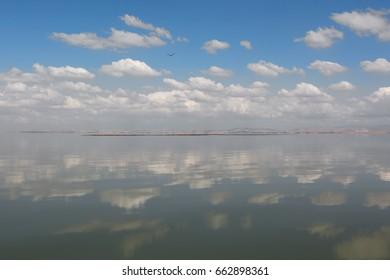 Manyas Lake with cloudscape and reflection. Bandirma. Turkey
