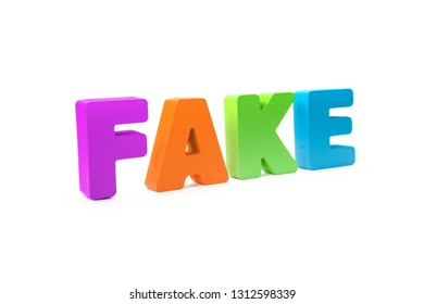 Many-colored isolated wooden word FAKE made with 3d text effect. Concept of false information, distortion of fact. Misinformation sign on white background. Mass media fake news. Falsehood about event