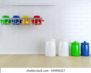 Many-colored kitchenware on the wooden worktop. Kitchen design.