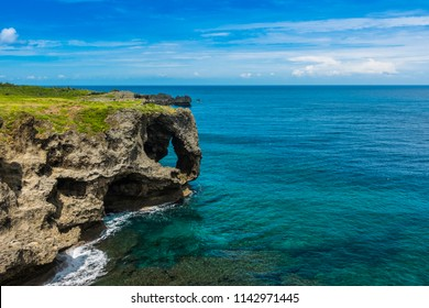 Manzamo cliff with blue sky, Turquoise sea in Okinawa, Japan, Travel destination in Japan, copy space