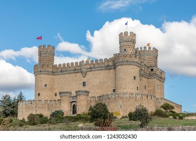 MANZANARES EL REAL, SPAIN -  NOVEMBER 15, 2018: Manzanares el Real Castle in Madrid, on a sunny day and autumn clouds in Spain.