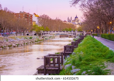 The Manzanares river cross the city of Madrid, Spain. Along its margins it is possible to enjoy a relaxing walk with beautiful views of monuments of the city, such as the Cathedral.