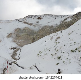 Manzano Sorafuki tourist spot, Vocanic activity on mountain slope, steam rising from hot surface, winter in Manza Onsen, Gunma