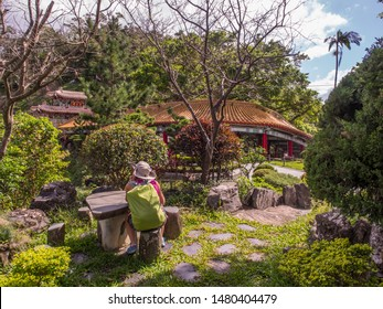 Maokong, Taiwan. Women with racksack in the park of  the Chih Nan Temple on the hills of Maokong  in Taiwan. Asia