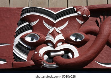 Maori carving - face carved in the wood. Rotorua, New Zealand.
