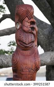Maori carving style wood figure of Tupu a Rangi in details