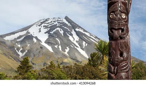 Maori statue in front of Volcano Taranaki, New Zealand