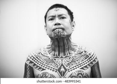 Maori tattooed man in Florence 2015, Italy. Editorial