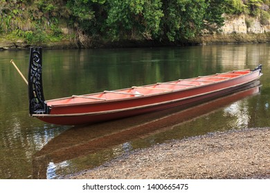 Maori Waka (Canoe) With Carved Stern Post on a River, New Zealand