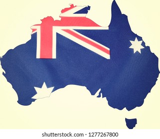 Map of Australia with Australian flag on white background, with applied vintage wash filter.