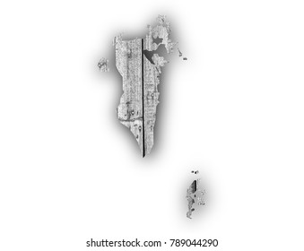 Map of Bahrain on weathered wood