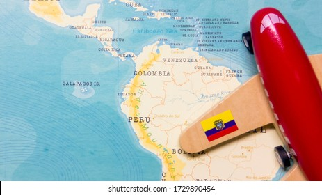 A map of Ecuador and a red plane with a flag of Ecuador attached to its wings.