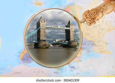 Map of Europe with magnifying glass looking in on Tower Bridge in London, England