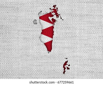Map and flag of Bahrain on old linen