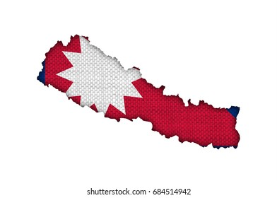 Map and flag of Nepal on old linen