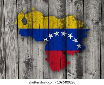 Map and flag of Venezuela on weathered wood