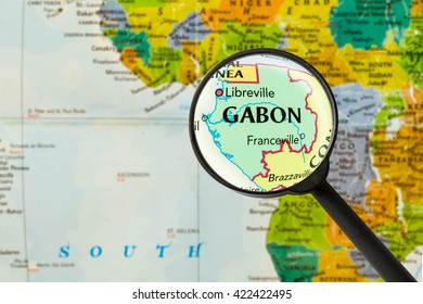 Map of Gabonese Republic through magnigying glass